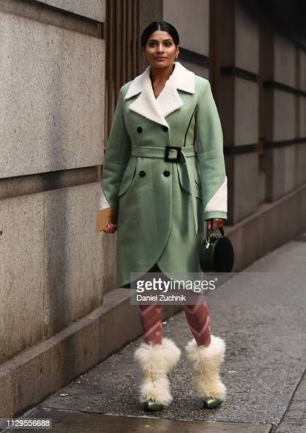 Guest is seen wearing a Michael Kors coat outside the Michael Kors show during New York Fashion Week: Fall/Winter 2019 on February 13, 2019 in New...