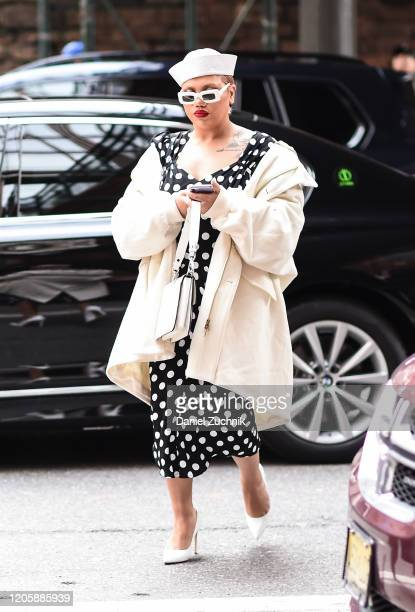 A guest is seen wearing a Michael Kors polkadot dress outside the Michael Kors show during New York Fashion Week A/W20 on February 12 2020 in New...