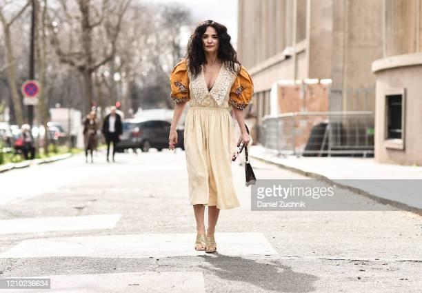 Guest is seen wearing a Miu Miu dress outside the Miu Miu show during Paris Fashion Week: AW20 on March 03, 2020 in Paris, France.