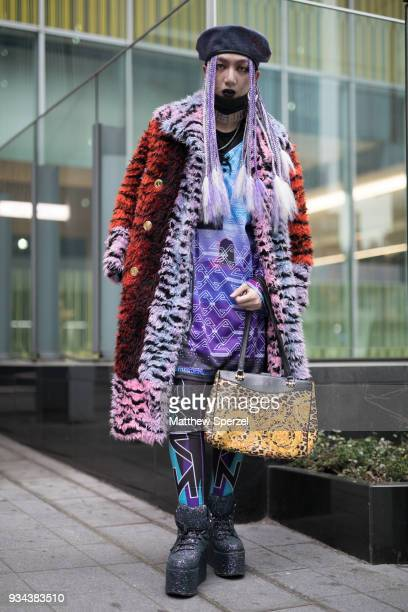 A guest is seen wearing a multicolor animal print fur coat and silver platform shoes during the Amazon Fashion Week TOKYO 2018 A/W on March 19 2018...