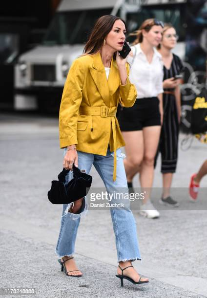 A guest is seen wearing a mustard jacket and jeans outside the Jason Wu show during New York Fashion Week S/S20 on September 08 2019 in New York City