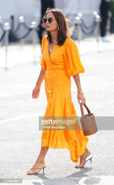 A guest is seen wearing a orange dress during New York Fashion Week on September 11 2019 in New York City