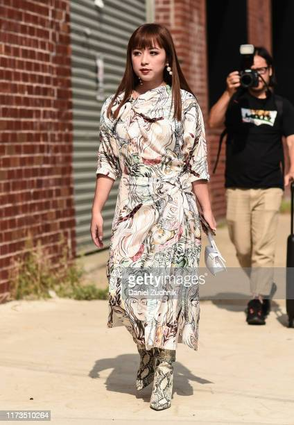Guest is seen wearing a Phillip Lim dress outside the Phillip Lim show during New York Fashion Week S/S20 on September 09, 2019 in Brooklyn, New York.