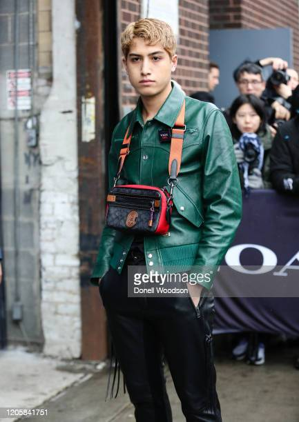Guest is seen wearing a pine green leather jacket, black pants and black, red and tan Coach bag outside of the Coach 1941 show during New York...