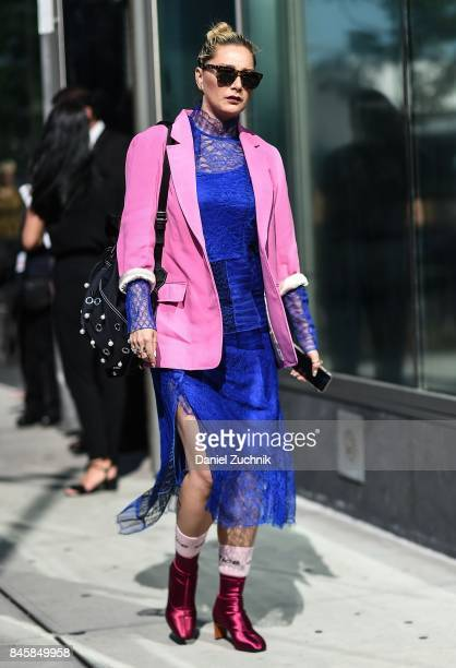A guest is seen wearing a pink jacket and blue dress outside the 31 Phillip Lim show show during New York Fashion Week Women's S/S 2018 on September...