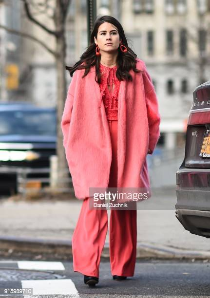 A guest is seen wearing a pink outfit outside the Tadashi Shoji show during New York Fashion Week Women's A/W 2018 on February 8 2018 in New York City