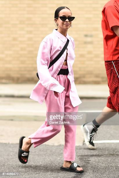 A guest is seen wearing a pink shirt and pants outside the General Idea show during New York Fashion Week Men's S/S 2018 at Skylight Clarkson Sq on...
