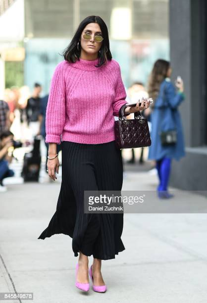 A guest is seen wearing a pink sweater and black skirt outside the 31 Phillip Lim show show during New York Fashion Week Women's S/S 2018 on...