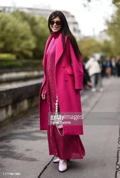 Guest is seen wearing a pink Valentino coat and dress outside the Valentino show during Paris Fashion Week SS20 on September 29, 2019 in Paris,...