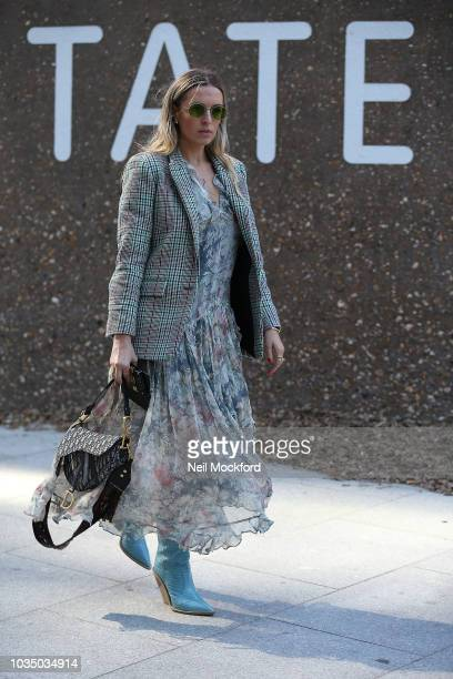 A guest is seen wearing a plaid blazer midi dress and a Dior saddle bag outside Christopher Kane at Tate Modern during London Fashion Week September...