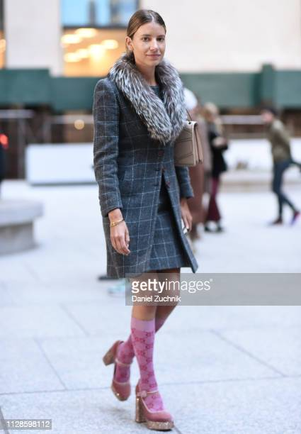A guest is seen wearing a plaid coat and skirt outside the Longchamp show during New York Fashion Week Fall/Winter 2019 on February 09 2019 in New...