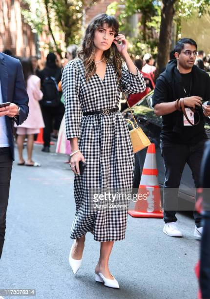 A guest is seen wearing a plaid dress and Gucci belt outside the Kate Spade show during New York Fashion Week S/S20 on September 07 2019 in New York...