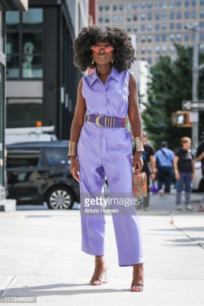 Guest is seen wearing a purple romper during New York Fashion Week on September 09, 2019 in New York City.