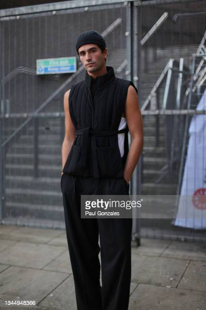 Guest is seen wearing a Quilted Black Gilet at COS during London Fashion Week September 2021 on September 21, 2021 in London, England.