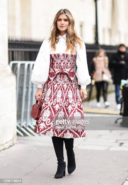 A guest is seen wearing a red and white Paco Rabanne dress outside the Paco Rabanne show during Paris Fashion Week AW20 on February 27 2020 in Paris...