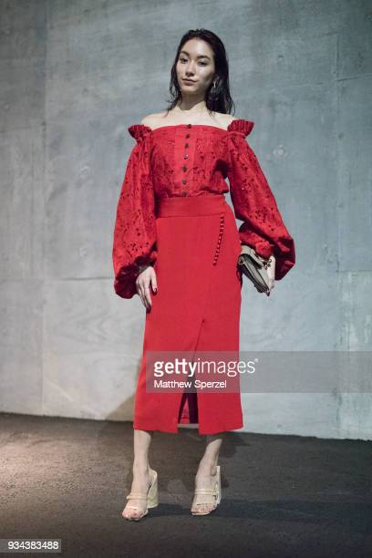 A guest is seen wearing a red dress with beige shoes during the Amazon Fashion Week TOKYO 2018 A/W on March 19 2018 in Tokyo Japan