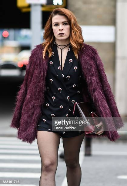 A guest is seen wearing a red fur coat and black blazer dress outside of the Nautica show during New York Fashion Week Men's AW17 on February 1 2017...