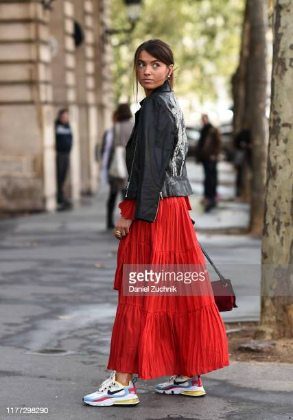 Guest is seen wearing a red Redemption dress outside the Redemption show during Paris Fashion Week SS20 on September 26, 2019 in Paris, France.