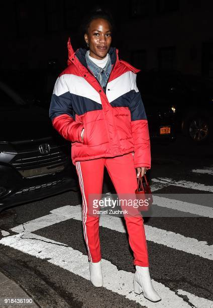 A guest is seen wearing a red white and blue jacket and red striped pants outside the Marc Jacobs show during New York Fashion Week Women's A/W 2018...