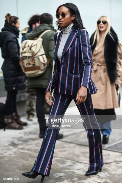 A guest is seen wearing a red white and blue suit at the Tibi show during New York Fashion Week Women's Fall/Winter 2017 on February 11 2017 in New...