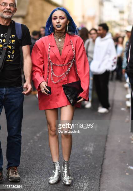 Guest is seen wearing a red with chains jacket and silver boots outside the APC show during Paris Fashion Week SS20 on September 30, 2019 in Paris,...