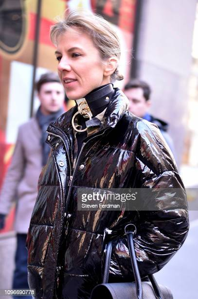 A guest is seen wearing a shiney black puffy jacket with leather choker outside the Christian Siriano show during New York Fashion Week Autumn Winter...