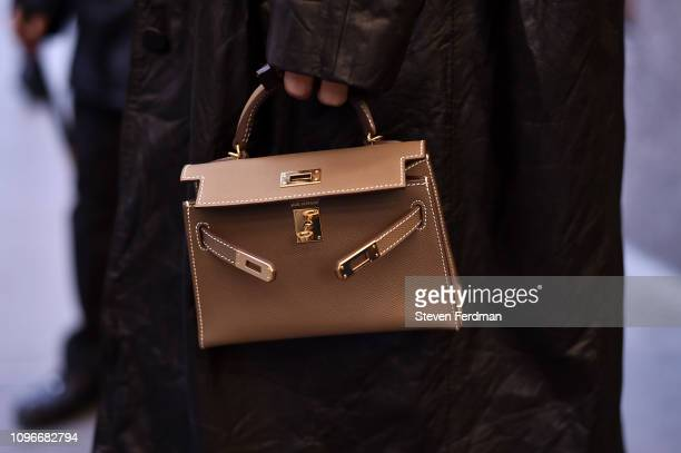 Guest is seen wearing a small Hermes bag outside the Christian Siriano show during New York Fashion Week Autumn Winter 2019 on February 08, 2019 in...