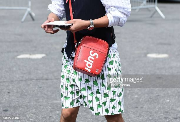 A guest is seen wearing a Supreme Louis Vuitton bag outside the Coach show during New York Fashion Week Women's S/S 2018 on September 12 2017 in New...