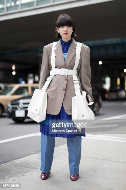 Guest is seen wearing a taupe blazer with white cargo harness, blue dress and light blue pants during the Amazon Fashion Week TOKYO 2018 A/W on March...
