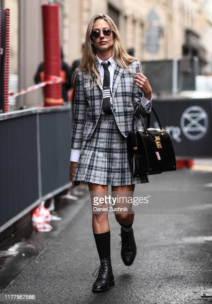 Guest is seen wearing a Thom Browne outfit outside the Thom Browne show during Paris Fashion Week SS20 on September 29, 2019 in Paris, France.