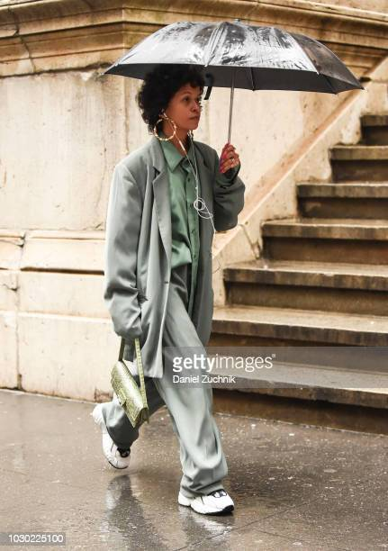 A guest is seen wearing a Tibi coat and pants outside the Tibi show during New York Fashion Week Women's S/S 2019 on September 9 2018 in New York City