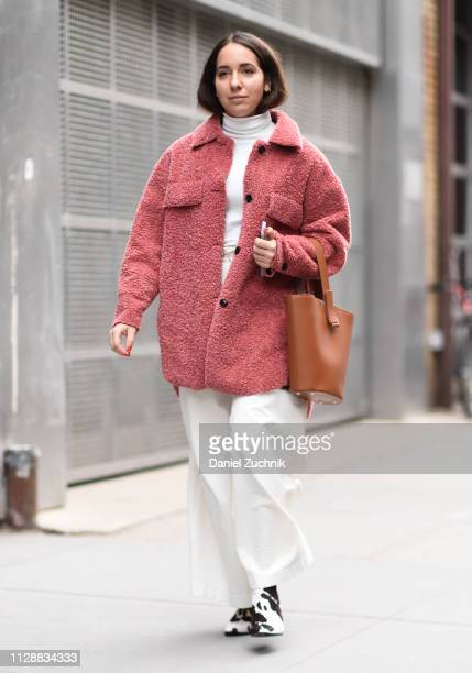 A guest is seen wearing a Tibi coat and white top and pants outside the Tibi show during New York Fashion Week Fall/Winter 2019 on February 10 2019...