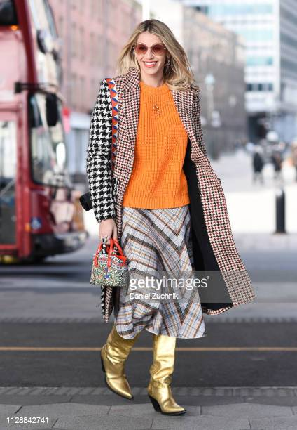 A guest is seen wearing a Tory Burch outfit outside the Tory Burch show during New York Fashion Week Fall/Winter 2019 on February 10 2019 in New York...