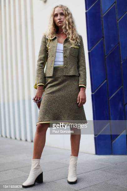 Guest is seen wearing a Tweed Suit at Richard Quinn during London Fashion Week September 2021 on September 21, 2021 in London, England.