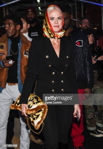 A guest is seen wearing a Versace scarf and bag outside the Versace PreFall 2019 Collection on December 2 2018 in New York City