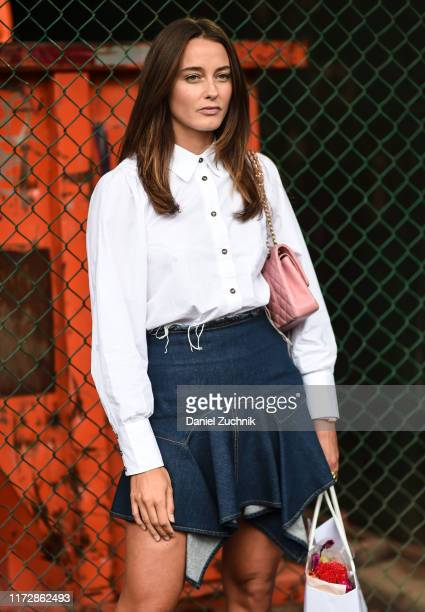 A guest is seen wearing a white blouse jean skirt and pink bag outside the Carlos Campos show during New York Fashion Week S/S20 on September 06 2019...