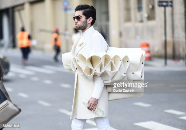 A guest is seen wearing a white coat with haute selfmade piece outside of the STAMPD show during New York Fashion Week Men's AW17 on February 2 2017...