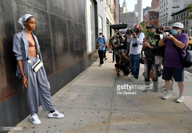 Guest is seen wearing a white head scarf, grey suit, white bag and white sneakers is seen outside of New York Fashion Week: The Shows at Spring...