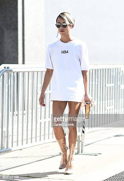 A guest is seen wearing a white Hood by Air top outside the J Crew show during New York Fashion Week Spring 2017 on September 11 2016 in New York City
