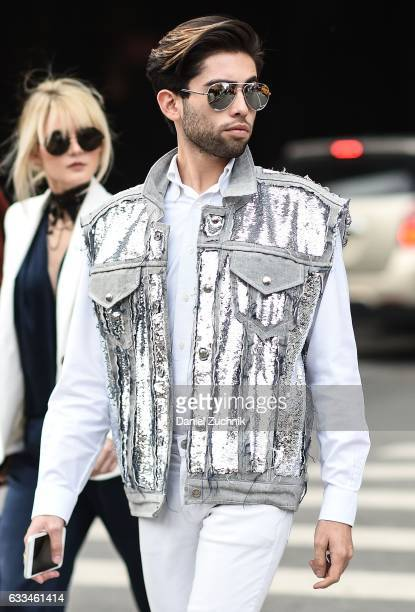 A guest is seen wearing a white shiny vest outside of the Rochambeau show during New York Fashion Week Men's AW17 on February 1 2017 in New York City