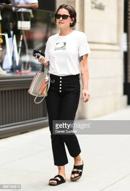 Guest is seen wearing a white shirt and black jeans outside the Death to Tennis show during the 2018 New York City Men's Fashion Week on July 11,...