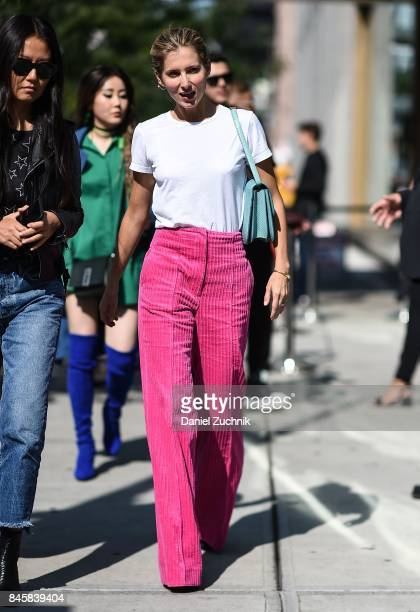 A guest is seen wearing a white shirt and pink pants outside the 31 Phillip Lim show show during New York Fashion Week Women's S/S 2018 on September...