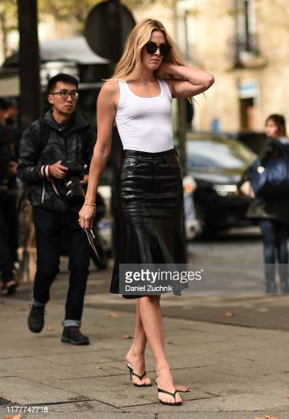 Guest is seen wearing a white top and black leather skirt outside the Altuzarra show during Paris Fashion Week SS20 on September 28, 2019 in Paris,...