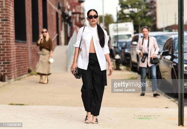 A guest is seen wearing a white top black pants and black sunglasses outside the Phillip Lim show during New York Fashion Week S/S20 on September 09...