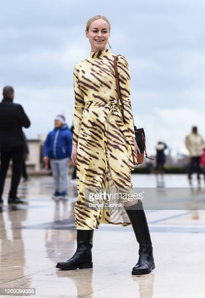 Guest is seen wearing a yellow and brown animal print dress with black boots outside the Ann Demeulemeester show during Paris Fashion Week: AW20 on...