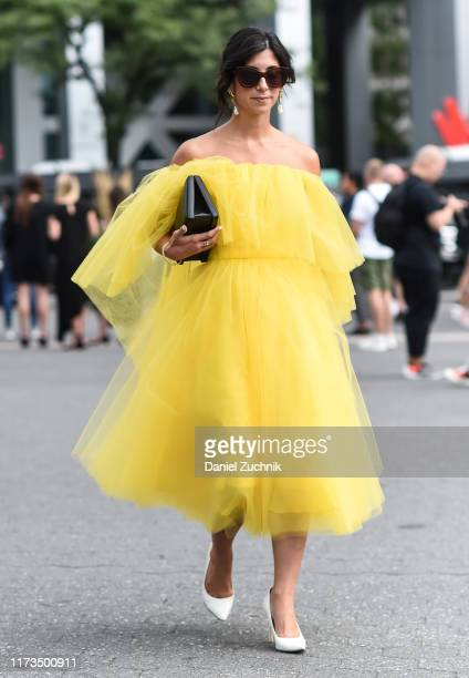 A guest is seen wearing a yellow Carolina Herrera dress and white heels outside the Carolina Herrera show during New York Fashion Week S/S20 on...