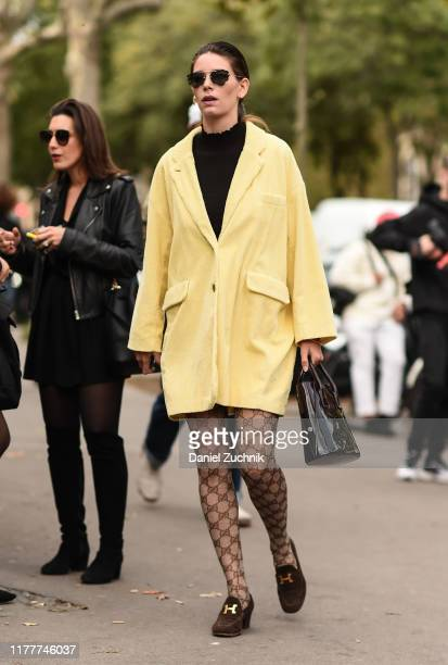 Guest is seen wearing a yellow coat outside the Haider Ackermann show during Paris Fashion Week SS20 on September 28, 2019 in Paris, France.