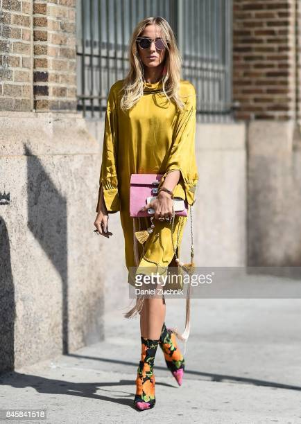 A guest is seen wearing a yellow dress outside the Zadig and Voltaire show during New York Fashion Week Women's S/S 2018 on September 11 2017 in New...