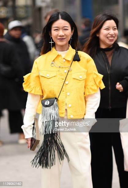 Guest is seen wearing a yellow jean jacket outside the 3.1 Phillip Lim show during New York Fashion Week: Fall/Winter 2019 on February 11, 2019 in...