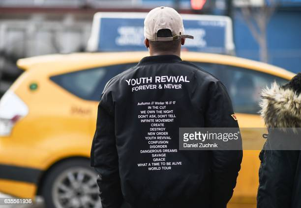 A guest is seen wearing a Youth Revival bomber jacket outside the Yeezy Kanye West show during New York Fashion Week on February 15 2017 in New York...